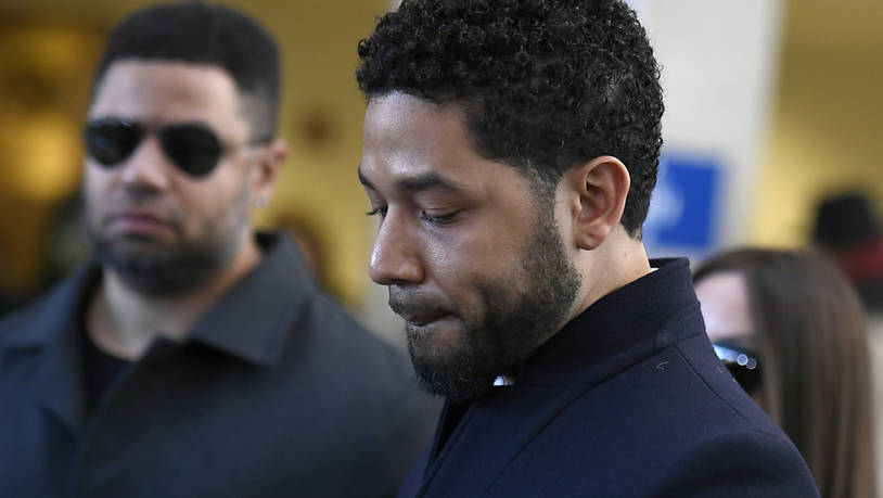 Actor Jussie Smollett looks on before leaving Cook County Court after his charges were dropped Tuesday, March 26, 2019, in Chicago. (AP Photo/Paul Beaty)