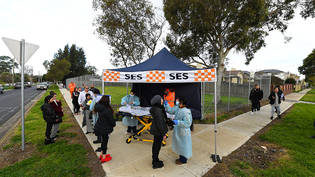A person receives a COVID-19 test at a Coronavirus pop-up testing facility in Broadmeadows, Melbourne, Friday, June 26, 2020. Coronavirus pop-up testing facilities have been setup in residential streets throughout area's considered coronavirus hotspots…